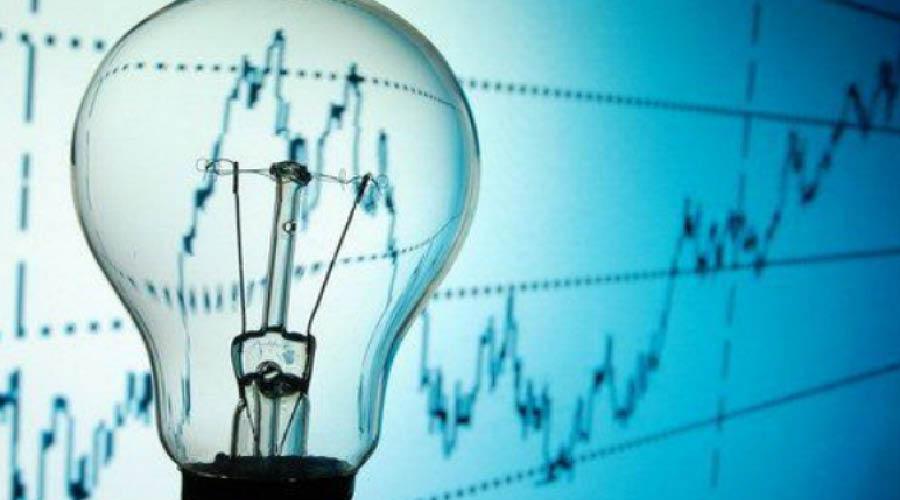 Une ampoule devant un graphique