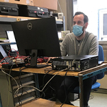 A technician working on an electronic device