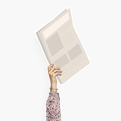 hand with a newspaper