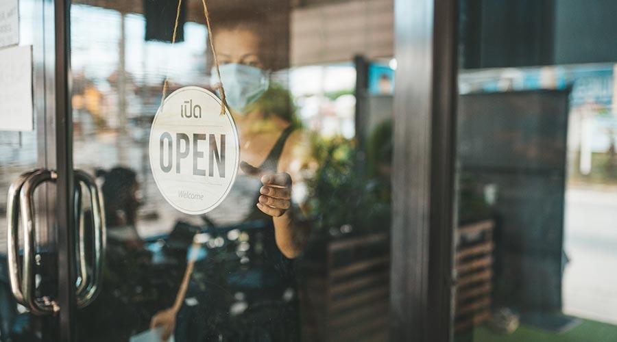 A shop door with the Open logo