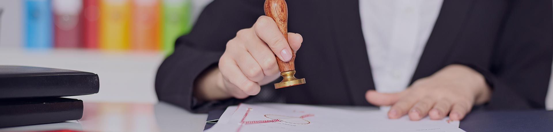 A woman stamping a document