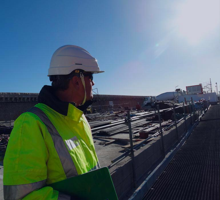 Helmeted man on a construction site