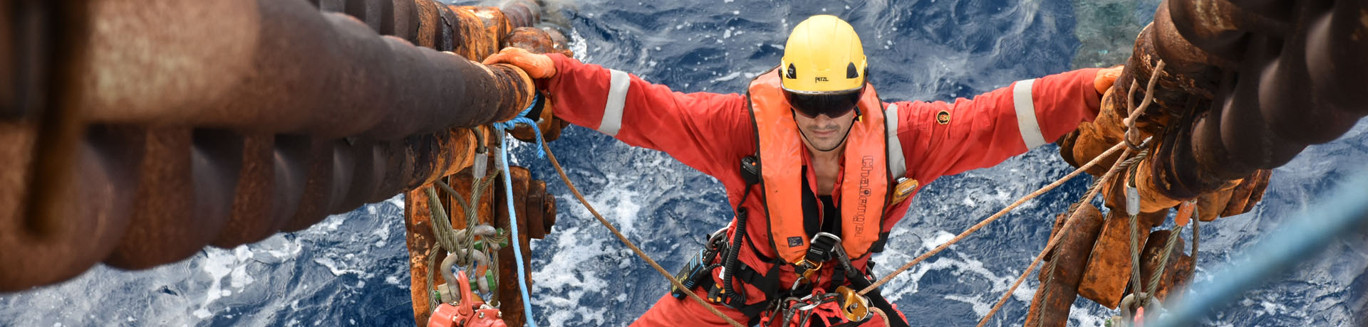A rope access technician carries out regulatory checks